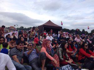 Afghans enjoying live music at cultural festival.
