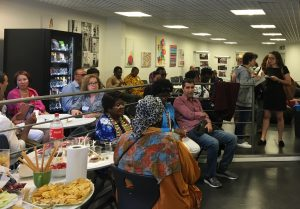 Migrants and Refugees exchange ideas, have fun and taste variety of food.