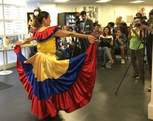 A migrant participant performs Columbian traditional dance.