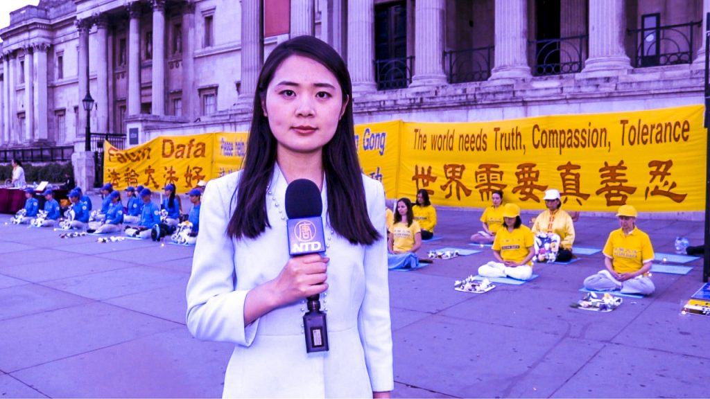 In front of National Gallery at Trafalgar Square, Sophia Sun reported on a rally of Falun Dafa practitioners calling for end the persecution in mainland China. Photo credit: Vanning