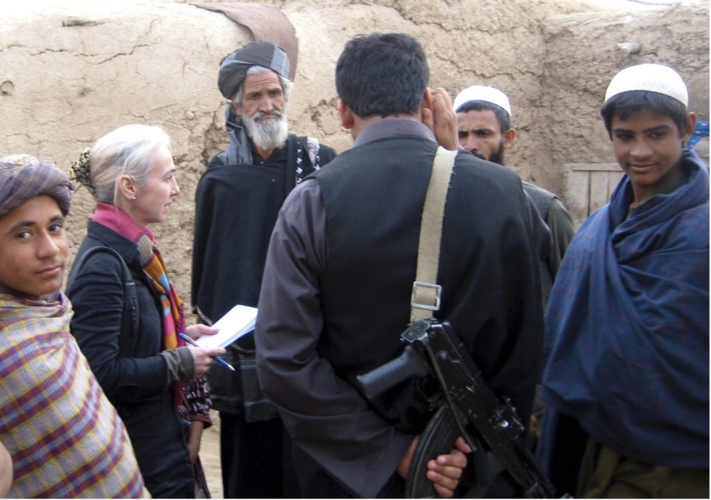 Lynne O'Donnell interviewing people in Helmand, Afghanistan, displaced by the US-led operation to clear Taliban from Marjah. Photo Credit to Behrouz Mehri.